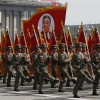 Soldiers carry an image of North Korea's founder Kim Il-sung during a military parade to celebrate the centenary of his birth in Pyongyang